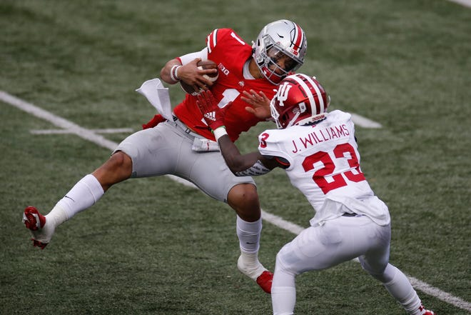 Indiana defensive back Jaylin Williams, right, knocks Ohio State quarterback Justin Fields to the ground during the first half of the Hoosiers' game against the Buckeyes on Saturday, Nov. 21, 2020, in Columbus, Ohio.
