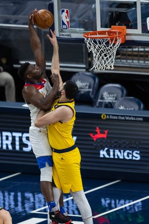 Feb 5, 2021; Indianapolis, Indiana, USA; New Orleans Pelicans forward Zion Williamson (1) shoots the ball over Indiana Pacers center Goga Bitadze (88) in the second quarter at Bankers Life Fieldhouse. Mandatory Credit: Trevor Ruszkowski-USA TODAY Sports