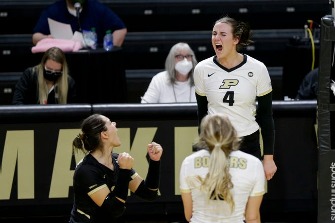 Purdue outside hitter Caitlyn Newton (4) celebrates a point during the fourth set of an NCAA women's volleyball game, Friday, Feb. 5, 2021 at Holloway Gymnasium in West Lafayette.