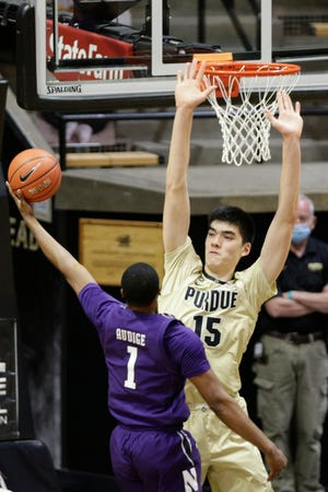 Northwestern guard Chase Audige (1) goes up for a shot against Purdue center Zach Edey (15) during the first half of an NCAA men's basketball game, Saturday, Feb. 6, 2021 at Mackey Arena in West Lafayette.