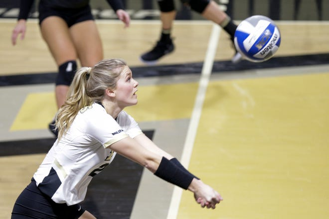 Purdue setter Hayley Bush (2) hits the ball during the second set of an NCAA women's volleyball game, Friday, Feb. 5, 2021 at Holloway Gymnasium in West Lafayette.