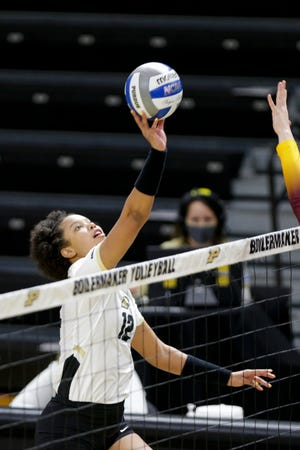 Purdue outside hitter Emma Ellis (12) hits the ball during the first set of an NCAA women's volleyball game, Friday, Feb. 5, 2021 at Holloway Gymnasium in West Lafayette.