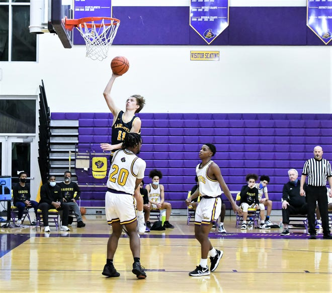 Lancaster's Keaton Phillips goes up for a shot against Reynoldsburg Friday night during a Ohio Capital Conference-Buckeye Division game at Reynoldsburg. The Gales lost, 66-35.