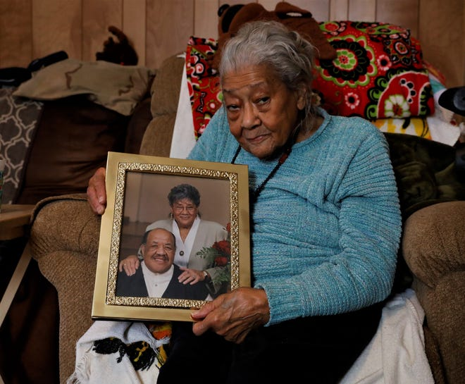 Alice Saunders holds a photo of herself and her husband, Kenneth, from her 50th wedding anniversary celebration in this Eagle-Gazette file photo. Saunders, 95, had been a civil rights leader in the area since the 1950s. She died of natural causes on May 1.