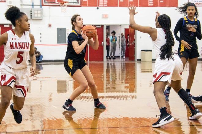 Bethlehem's Ella Thompson lines up the shot against Manual on Saturday. 2/6/21