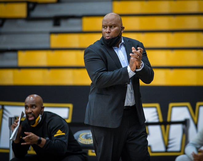 Milwaukee Panthers head coach Pat Baldwin applauds a play against the Northern Kentucky Norse in a Horizon League men's basketball game Friday, February 5, 2021, at the Klotsche Center in Milwaukee, Wisconsin.