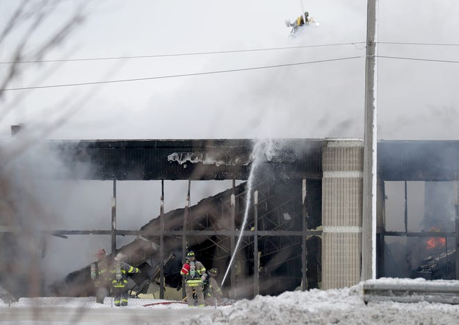 Firefighters work to extinguish a commercial structure fire near Springdale Road and Doral Road just north of I-94 in Waukesha County on Saturday, Feb. 6, 2021.