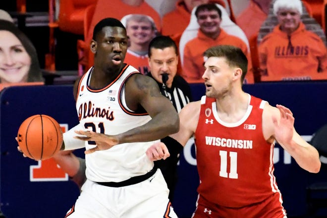 Illinois center Kofi Cockburn controls the ball as he is pressured by Wisconsin's forward Micah Potter in the first half Saturday in Champaign, Ill.