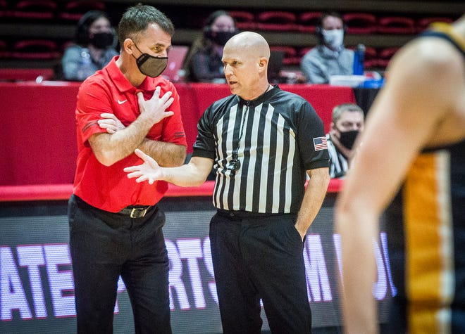 BSU coach James Whitford speaks with an official during the Cardinals' game against Toledo at Worthen Arena Saturday, Feb. 6, 2021.