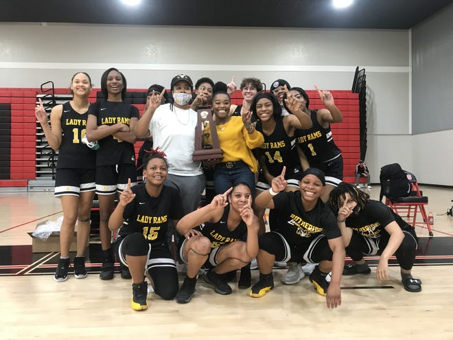 The Rutherford girls basketball team celebrates its 71-40 victory over West Florida in the District 1-4A championship on Feb. 5, 2021 in Pensacola.
