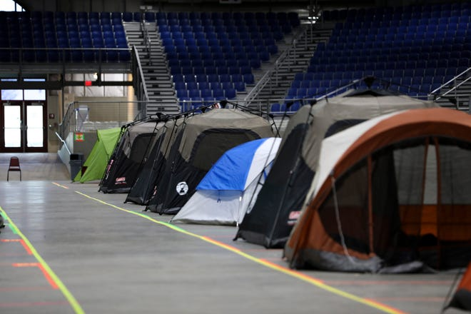 Occupied tents fill the temporary houseless shelter inside of The Pavilion in Salem.