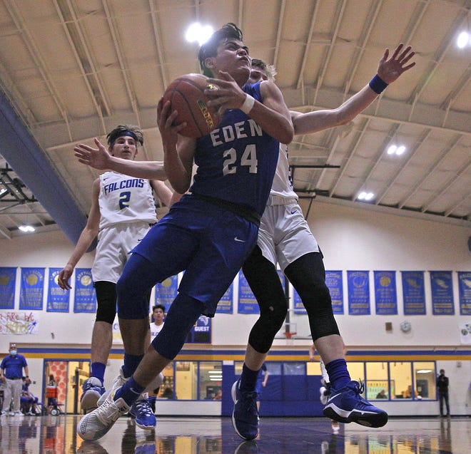 Eden's Julian Gamboa, center, drives to the basket during a game against Veribest on Friday, Feb. 5, 2021.