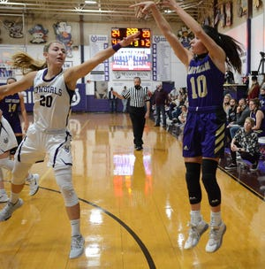 San Saba High School's Brighton Adams (10) fires off a shot from behind the 3-point arc as Mason's Tristin Keller (20) defends during a District 29-2A girls basketball game in Mason, Friday, Feb. 5, 2021.