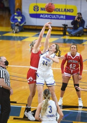South Dakota State's Myah Selland and South Dakota's Hannah Sjerven tip off on Friday, Feb. 5, at Frost Arena in Brookings.