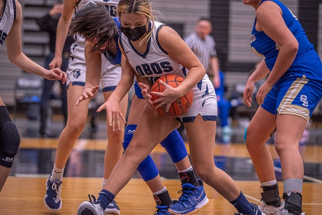 Mountain View player Violet Slosar fights the ball away from a San Elizario player. Mountain View High School defeated San Elizario High School 40-32 in 1-4A varsity girls basketball at the Horizon High School gym on Feb. 5, 2021.