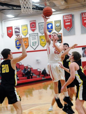 Landen Russell goes in for a shot during Sheridan's 75-41 win against visiting Tri-Valley on Feb. 5 at Glen Hursey Gymnasium.