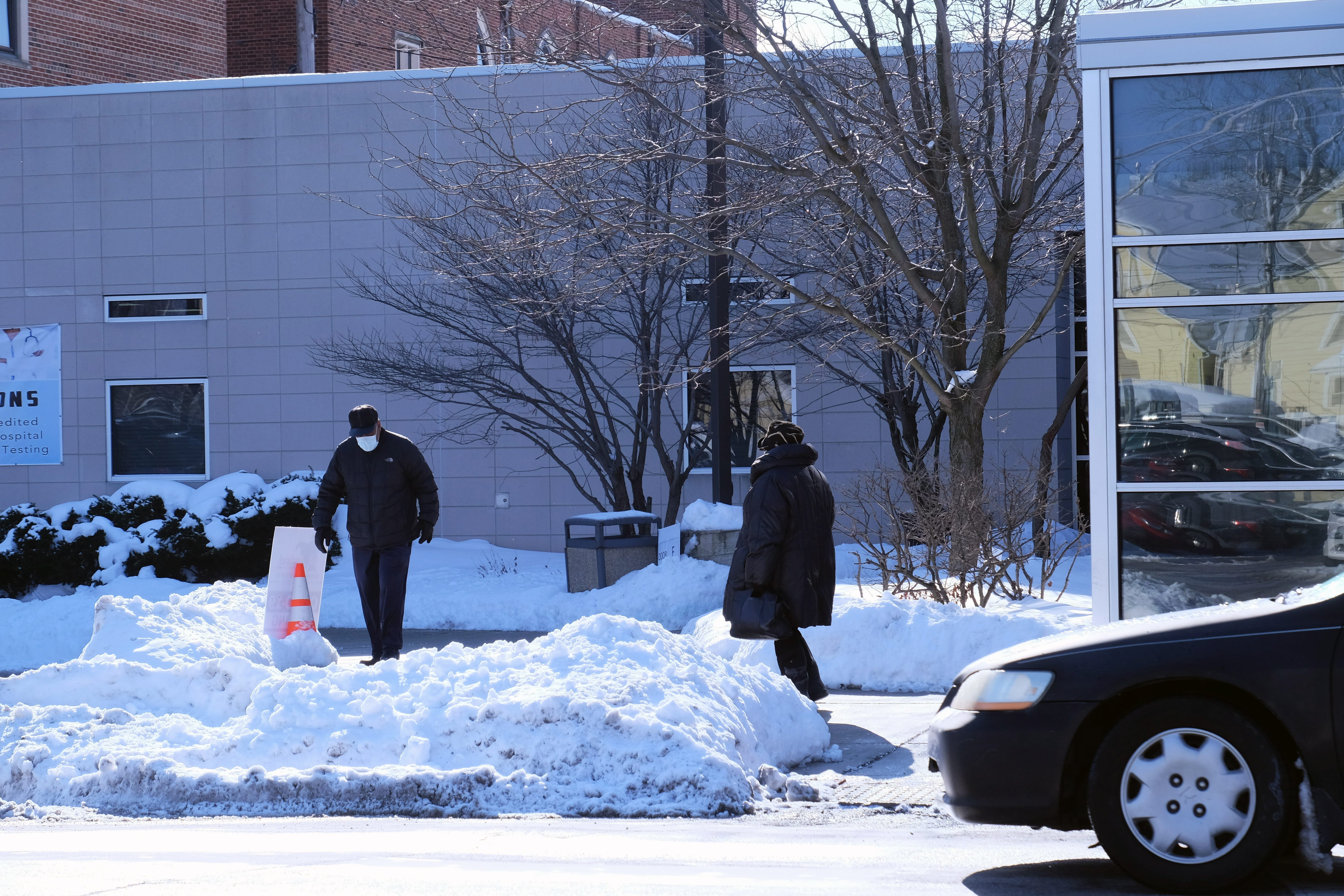 People from across Chicago trickled in and out of Roseland Community Hospital on the city's far south side in the 12-degree weather on Feb. 5. The hospital offered COVID-19 vaccinations by appointment.