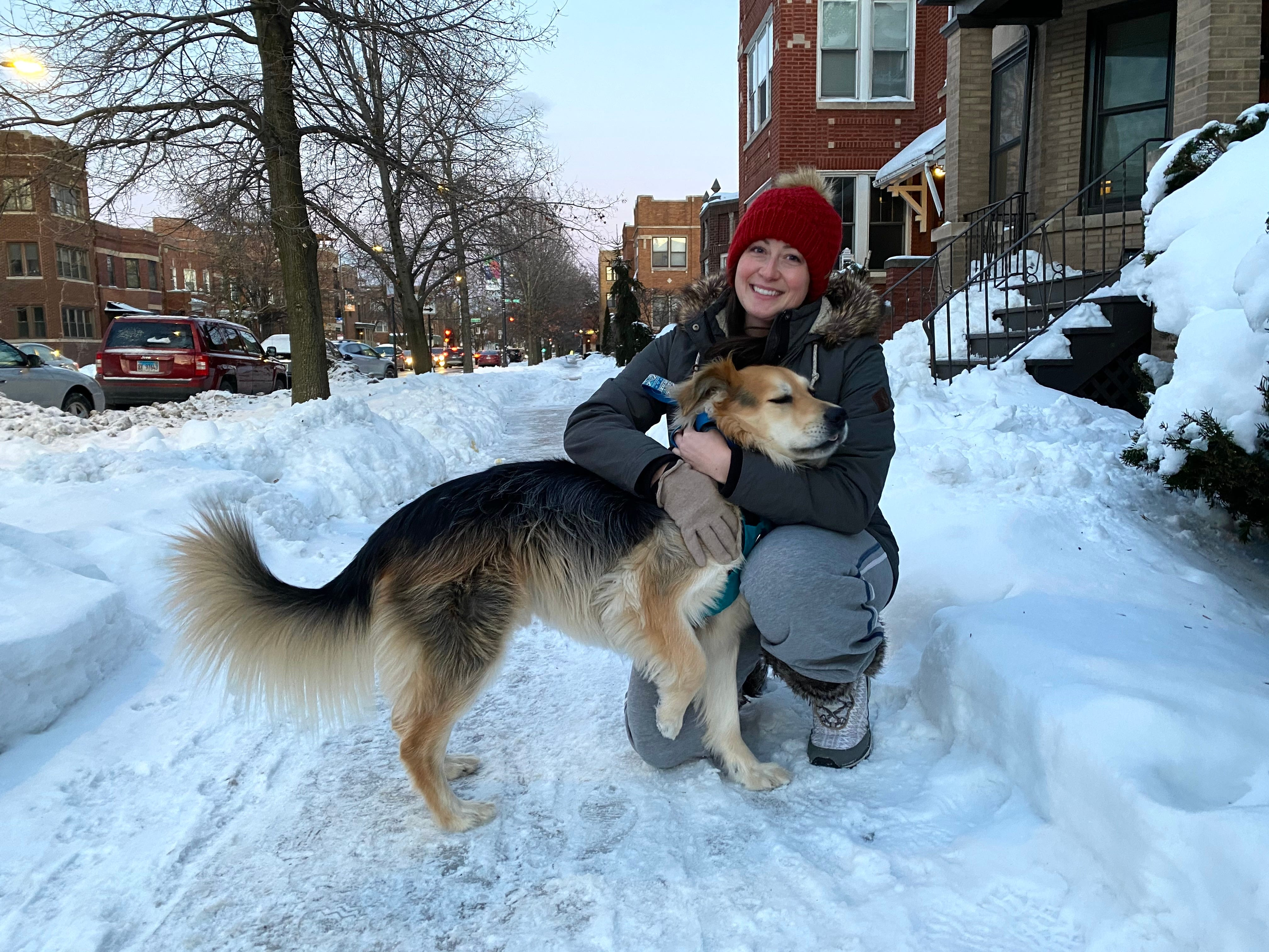 Former pharmacist Marissa Hampton, 35, walks her dog, Renly, in Chicago's North Center neighborhood Feb. 5. Hampton says she has administered dozens of shots for other viruses and plans to get a COVID-19 vaccine as soon as possible.