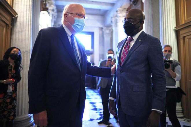 Senate President Pro Tempore Patrick Leahy, D-Vt., speaks with Sen. Raphael Warnock, D-Ga., outside the Senate chamber on Jan. 28. Leahy will preside over the second impeachment trial of Donald Trump.