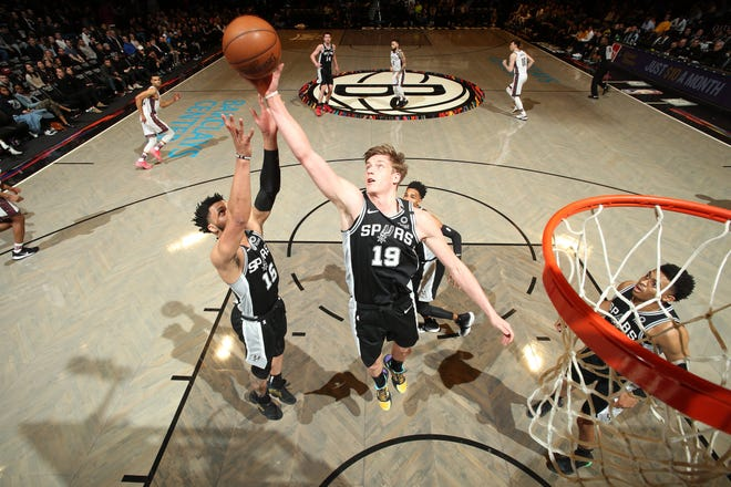Luka Samanic (center) of the San Antonio Spurs reaches for the ball during the game against the Brooklyn Nets in March of 2020 at Barclays Center in Brooklyn, New York. He's currently playing for the Austin Spurs in the G League, which will be held entirely in the bubble at the Walt Disney Resort in Orlando, Fla.