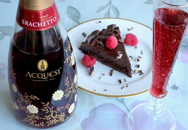 A bottle of Acquesi brachetto pairs perfectly with a flourless chocolate cake and chocolate mousse bomb from Oh So Sweet bakery on Thursday, Jan. 21, 2021 in Cuyahoga Falls, Ohio. [Phil Masturzo/ Beacon Journal]
