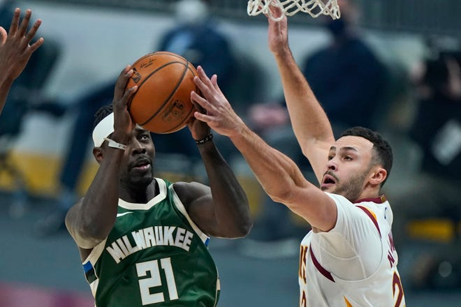 Cavaliers forward Larry Nance Jr., right, suffered a broken finger during Saturday night's loss to the Milwaukee Bucks and is expected to be out for about six weeks. [Tony Dejak/Associated Press]
