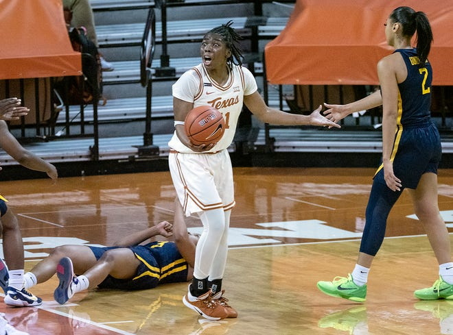 Texas guard Joanne Allen-Taylor (11) expresses surprise after she was called for a charging foul against West Virginia's Kirsten Deans (3) at the Erwin Center in Austin on Saturday. The Longhorns struggled near the end of the game as they fell to West Virginia for a second time this season.