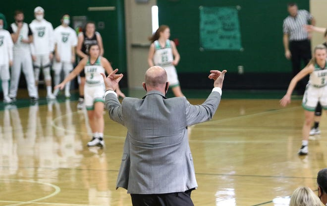 West Branch coach Walt DeShields motions to his players from in front of the bench during action at West Branch High School Saturday, February 6, 2021.
