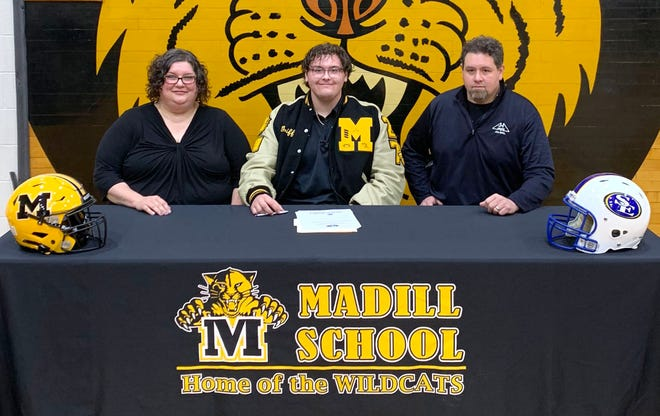 Madill senior Griffon Williams is joined by his parents as he signs his letter of intent to play football at Southeastern Oklahoma State University.