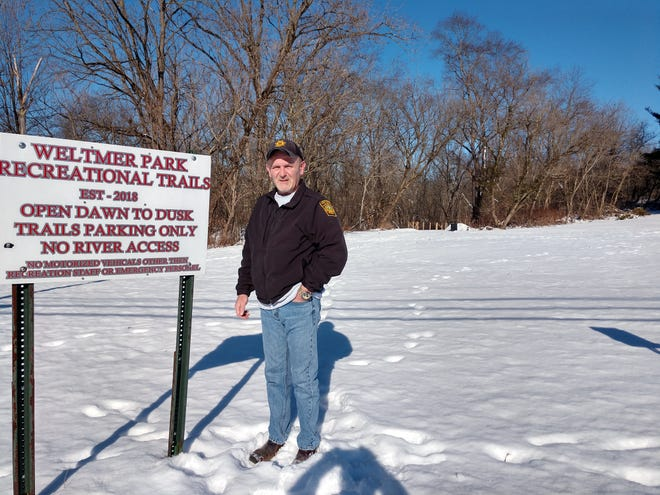Joe Eggerton, founder and president of Perrysville Economic Development, poses at the south entrance of the Weltmer Park recreational trail, one of the major successes of the totally volunteer economic development group.