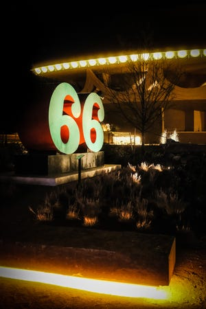 The iconic 66 sign at Unity Square and the Bartlesville Community Center glow on a recent evening.