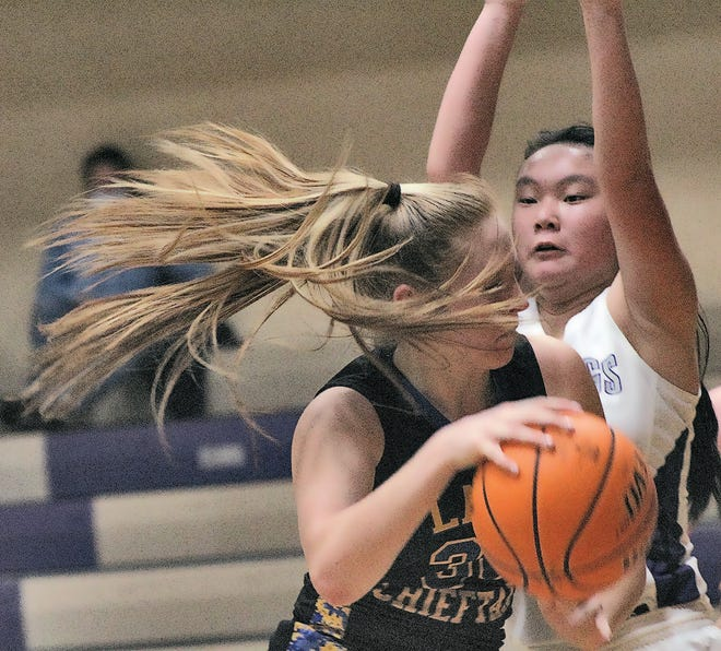 Wesleyan Christian School's Chaney Odden, right, obstructs the path of an opposing ballhandler during varsity girls basketball action this season.