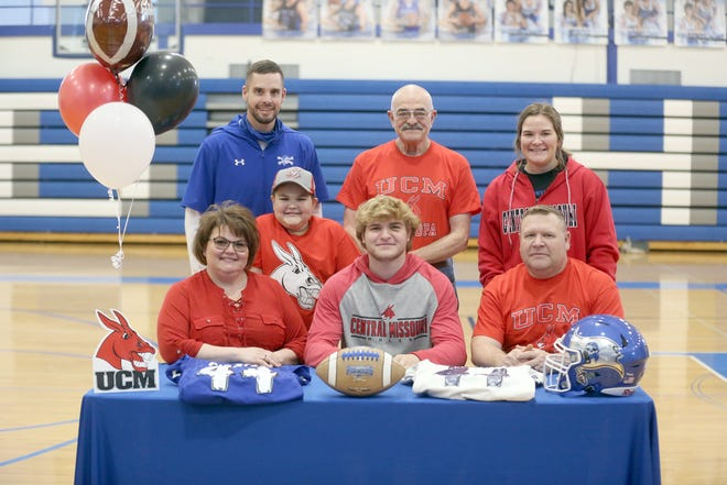 Boonville senior Lane West signed a football letter of intent last Wednesday with the University of Central Missouri in Warrensburg. On hand during the signing were (left to right) Cynda Beach, Lane West and Gerry West. (back row, left to right) Boonville football coach Greg Hough, Kale West, Ned Beach and Emma West.