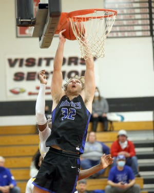 Boonville senior Charlie Bronakowski goes in for the dunk in the fourth quarter Saturday night against Battle in the championship game in the Southern Boone Tournament in Ashland.