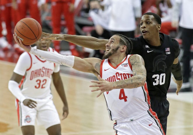 Guard Duane Washington Jr. (4) is a scorer who can give Ohio State points in bunches, but the Buckeyes have enough balance that they don't have to rely on him.