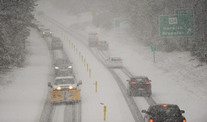 Drivers make their way down Route 6 near Exit 82, formerly Exit 10, as a heavy wet snow falls early Sunday afternoon. The weather caused several snow-related crashes during the day.