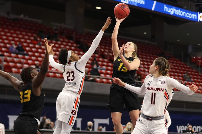 Missouri guard Haley Troup (13) shoots the ball during a game against Auburn on Sunday at Auburn Arena in Auburn, Ala.
