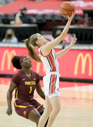 Ohio State Buckeyes guard Jacy Sheldon (4) is guarded by Minnesota Golden Gophers guard Alexia Smith (1) during the first quarter of Sunday's NCAA Division I Big Ten conference basketball game at Value City Arena in Columbus, Ohio, on February 7, 2021.