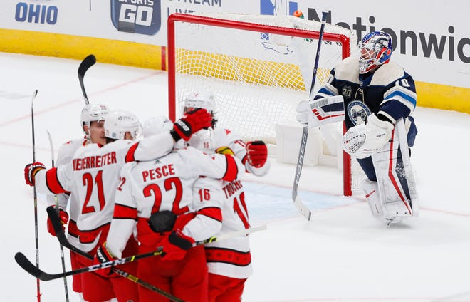 Columbus Blue Jackets goaltender Joonas Korpisalo (70) watches as Carolina Hurricanes players celebrate a goal by center Vincent Trocheck (16) during the second period of the NHL hockey game at Nationwide Arena in Columbus on Sunday, Feb. 7, 2021.