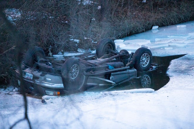 A car is submerged in the water after it jumped a barrier wall on the entrance ramp from Dublin Road to 670 Eastbound in Columbus, Ohio on February 6, 2021. Two people involved in the accident were pronounced dead, two others are being treated at local hospitals.