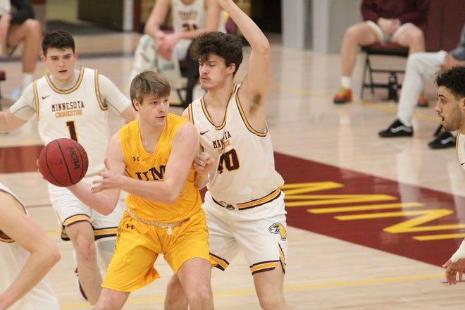 Georges Darwiche (1) and Hunter Lyman (40) defend during Minnesota Crookston's 84-45 loss at Minnesota Duluth Saturday afternoon.