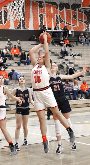 Meadowbrook's Lynsey Dudley (15) goes up for a shot during Saturday's Muskingum Valley League game with Morgan at Meadowbrook High School.