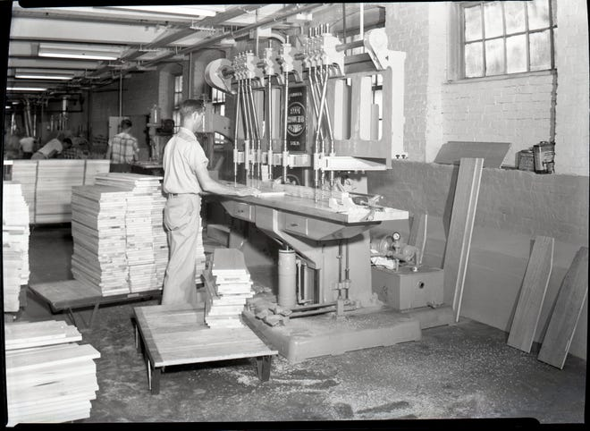 In the early 20th century, furniture and textile manufacturing were the major industry in Davidson County. Most production, such as this worker creating parts with a table saw, was done by hand.