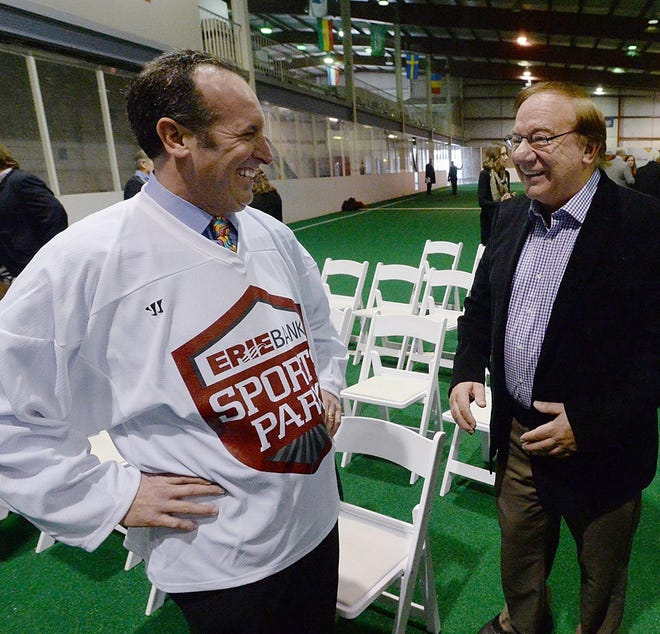 ErieBank President Dave Zimmer, left, talks with Scott Enterprises President Nick Scott on Dec. 14, 2017, after announcing the naming of ErieBank Sports Park, formerly Family First Sports Park, in Summit Township.