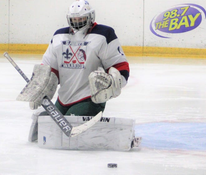 St. Thomas/Winnacunnet/Dover goalie Diana Pivirotto turns away a shot in the third period of Saturday's 9-0 win over Kingswood.