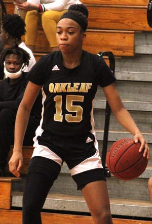 Oakleaf forward Fantasia James (15) dribbles during a high school girls basketball game against Parker on January 20, 2021. [Clayton Freeman/Florida Times-Union]