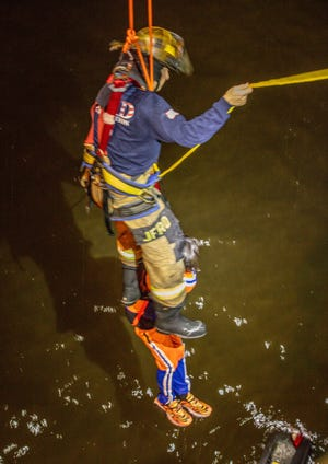 Jacksonville Fire and Rescue Department first responders rescued a 27-year-old man after his car plunged off the Dames Point Bridge into the St. Johns River as the result of a two-car crash Saturday night. The man sustained minor injuries, the Florida Highway Patrol said.