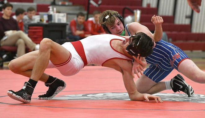 Tuslaw's Devyn Vanest wrestles against Northwest's Mason Goliath during a 2020 match. Vanest won his second PAC-7 individual championship last weekend for the Mustangs.