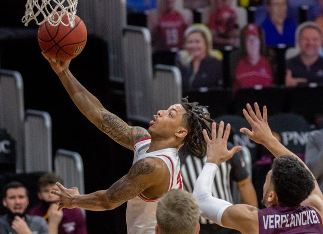 Bradley's Kevin McAdoo breaks through the SIU defense for a score in the first half Saturday, Feb. 6, 2021 at Carver Arena in Peoria.