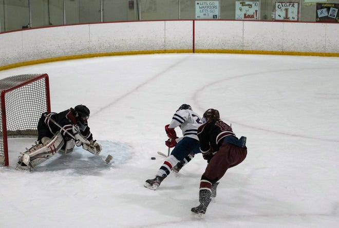 Lincoln-Sudbury senior Jacob Noyes shoots and scores on Concord-Carlisle senior goalkeeper Clark Stephenson, putting LS up 2-0 during the annual Warriors 4 Warriors/Patriots 4 Patriots game in Marlborough, Feb. 6, 2021. Lincoln-Sudbury bested the Patriots, 4-2.